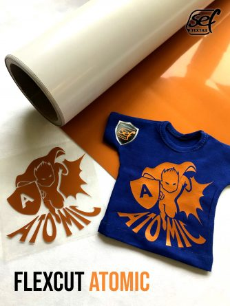 transfer and cut film for textile application in bright orange color, applied to a blue t-shirt for product demonstration.
